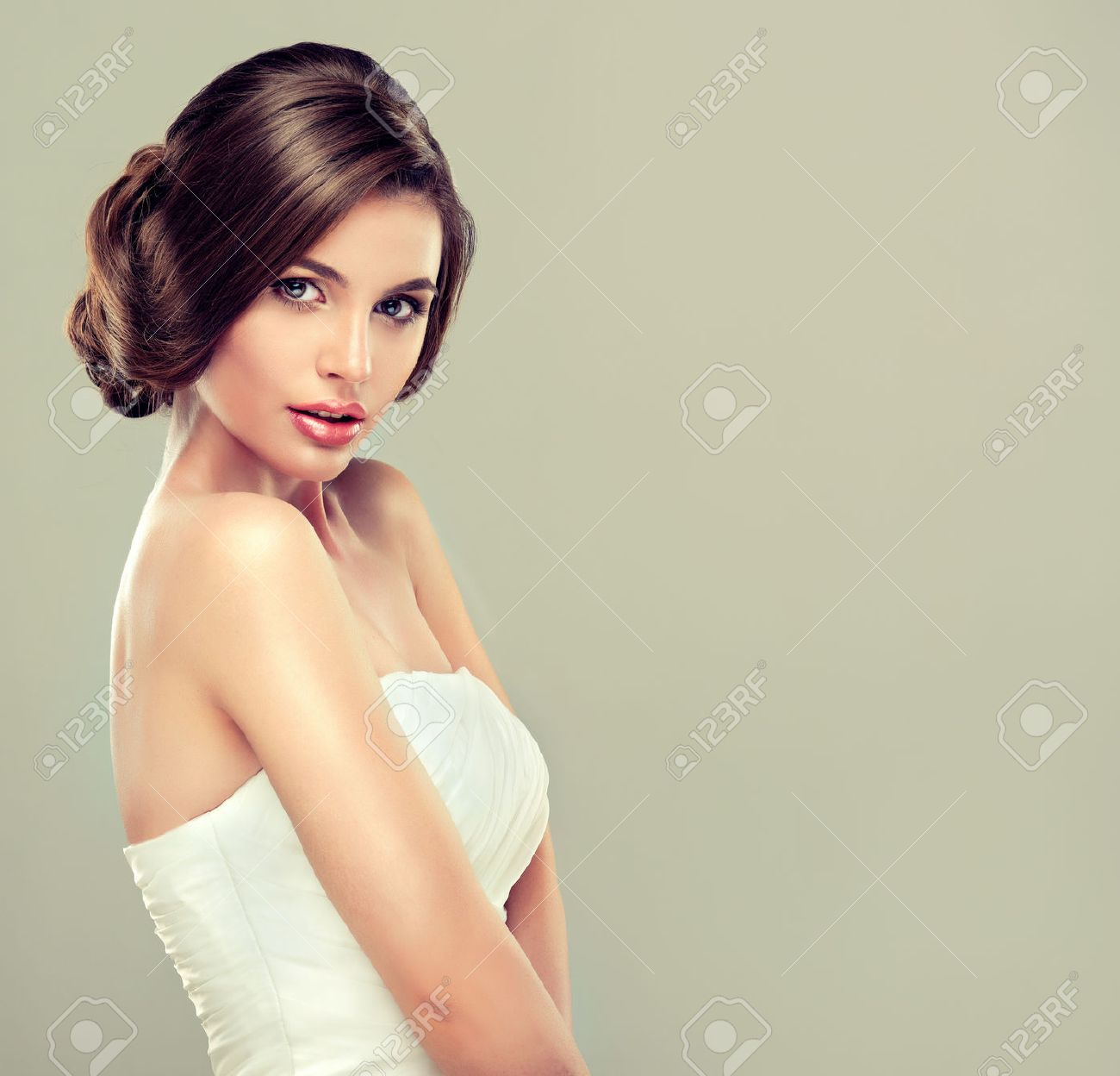Girl Bride In Wedding Dress With Elegant Hairstyle. Stock Photo ...