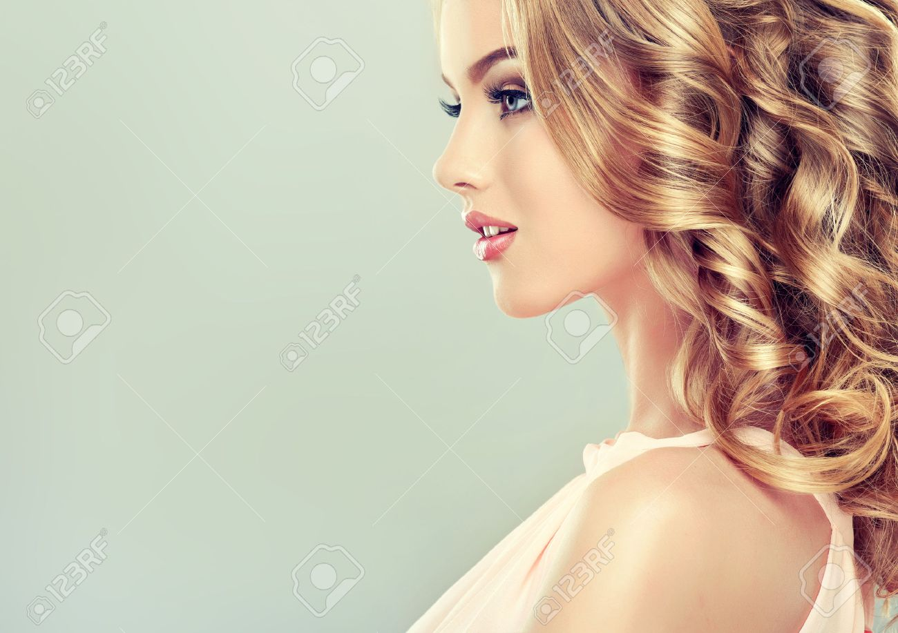 smiling beautiful light brown hair with an elegant hairstyle
