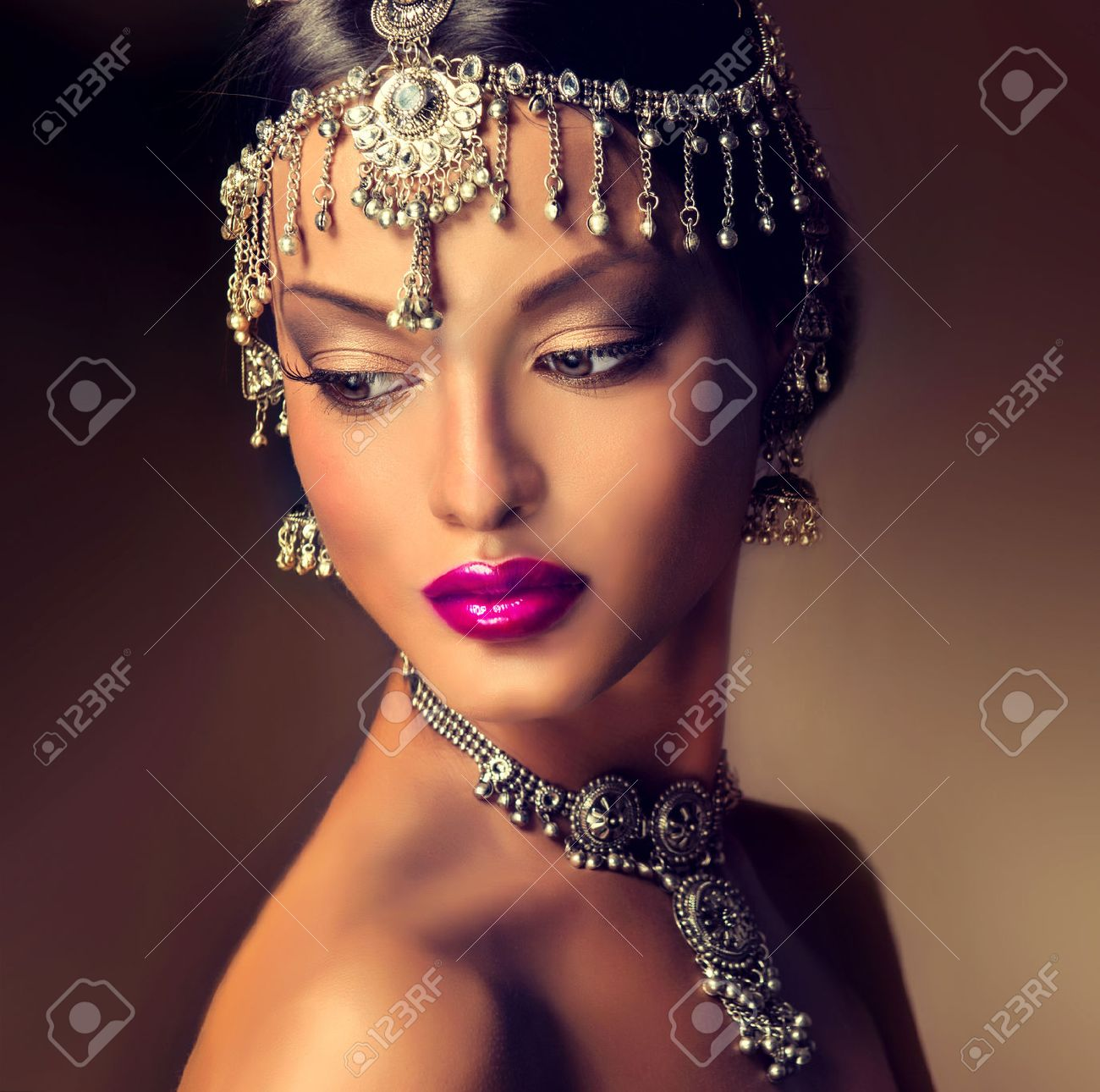 Beautiful Indian women portrait with jewelry. elegant Indian girl looking  to the side, bollywood