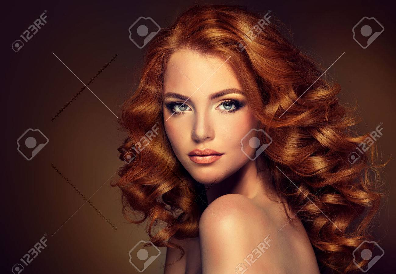 Girl model with long curly red hair. Trendy image of a red head woman - 46401811