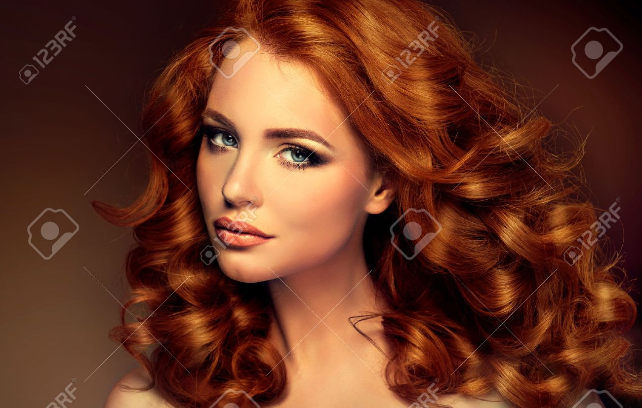 Girl model with long curly red hair. Trendy image of a red head woman - 46883266