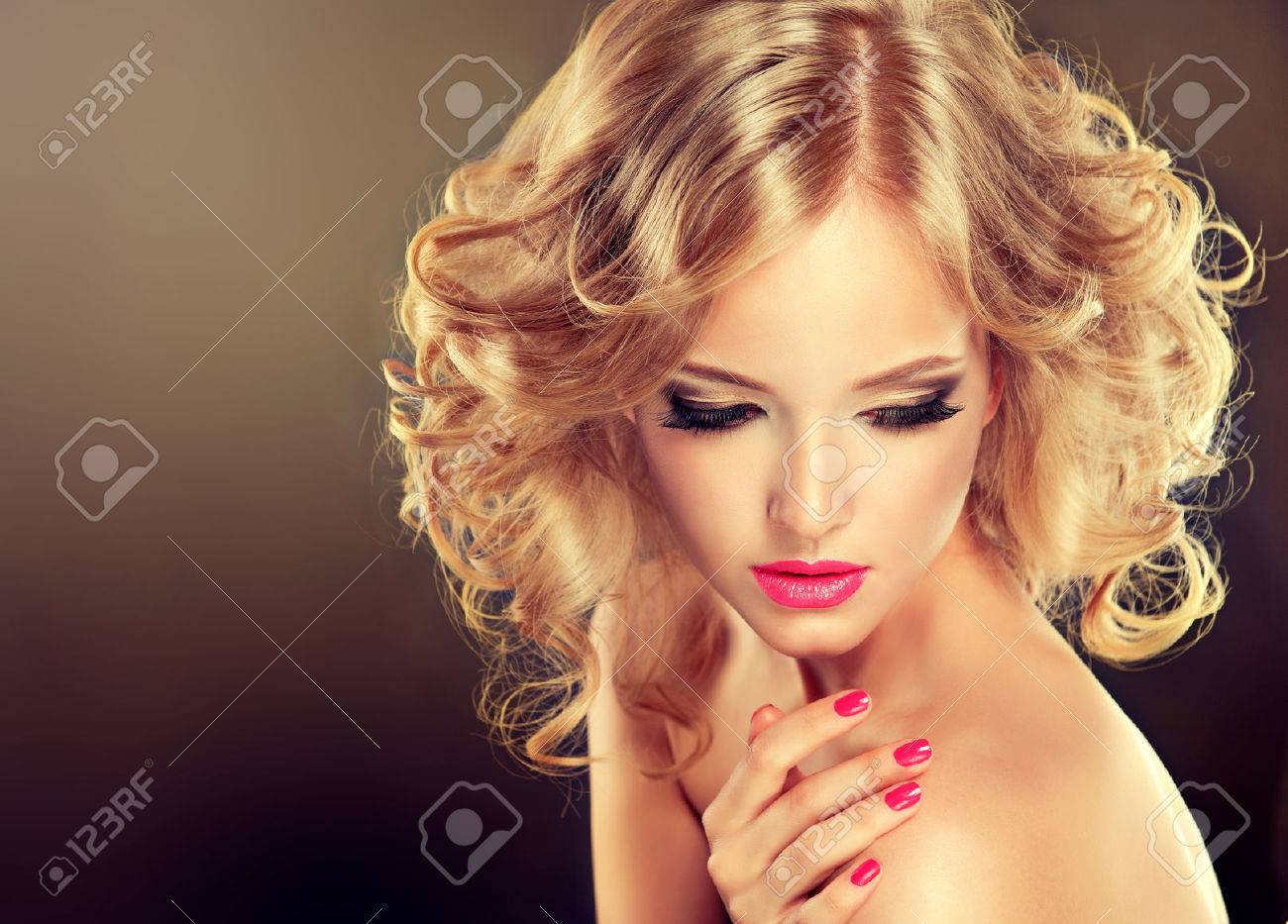 Pretty blonde girl with hairstyle curled hair .Luxury fashion style, manicure. - 47686169