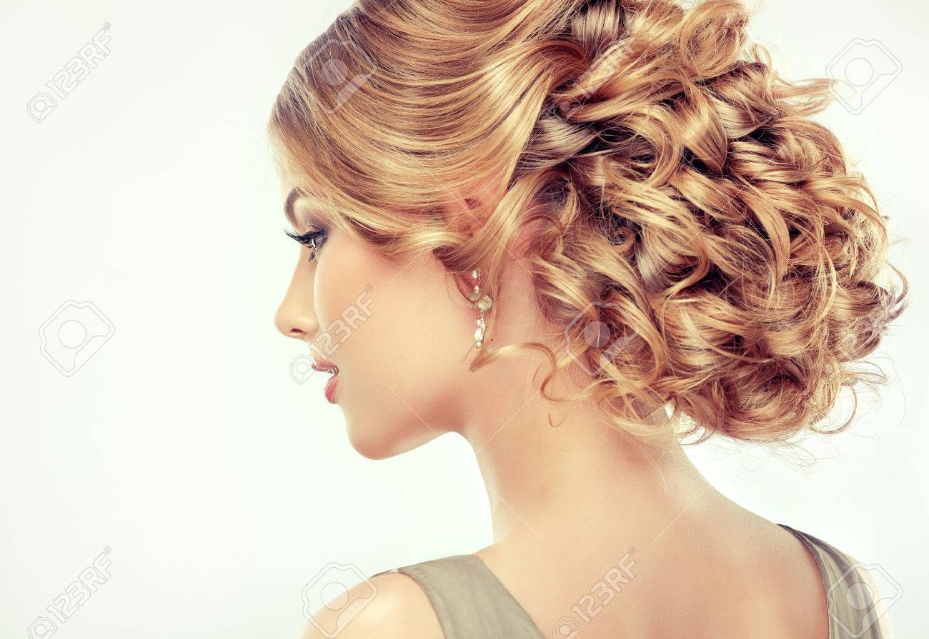 Beautiful girl light brown hair with an elegant hairstyle , hair wave ,curly hairstyle - 47900481