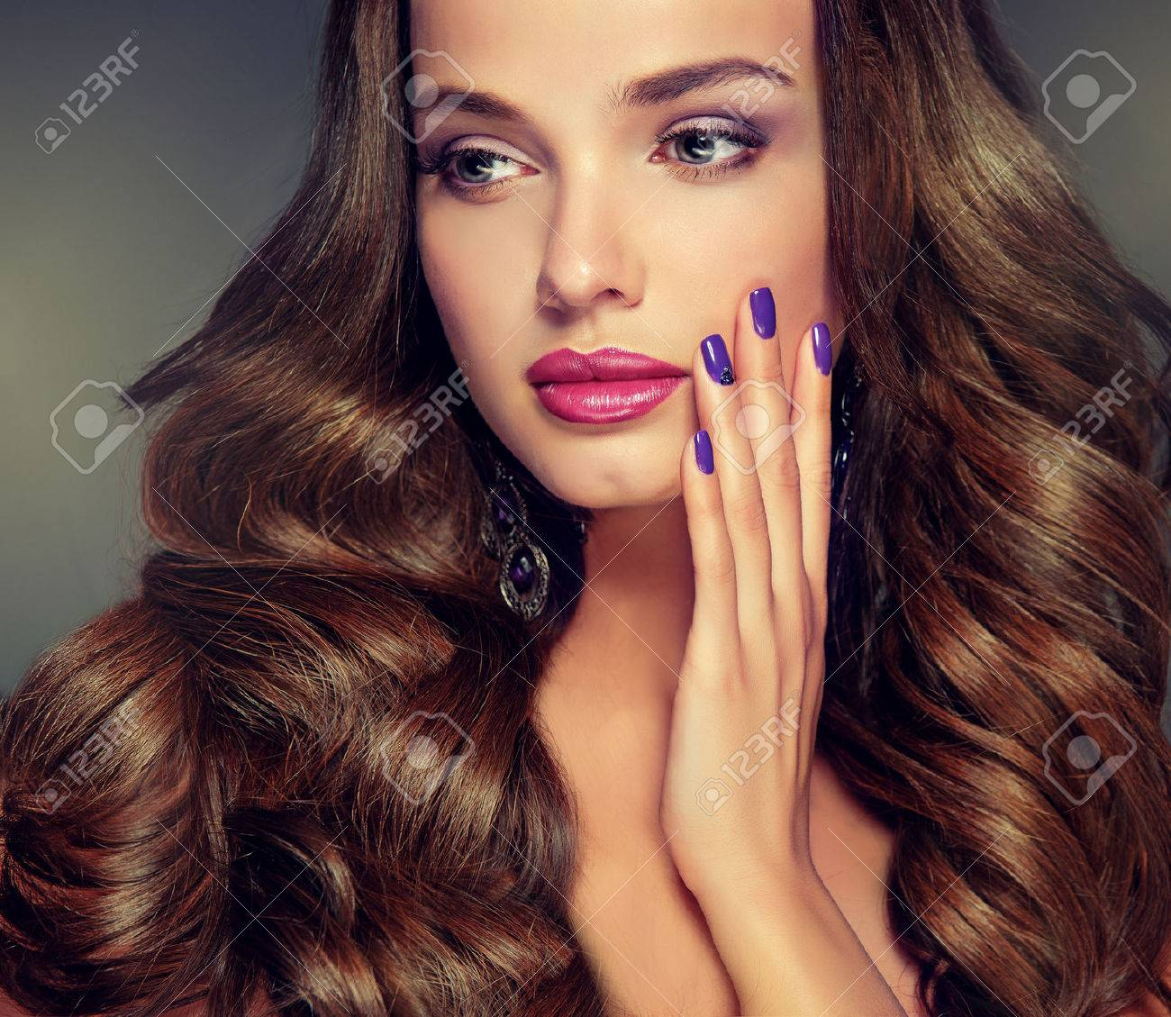 Nice young girl model with dense, curly hair. Bright fashionable make up and hairstyles. - 48840974