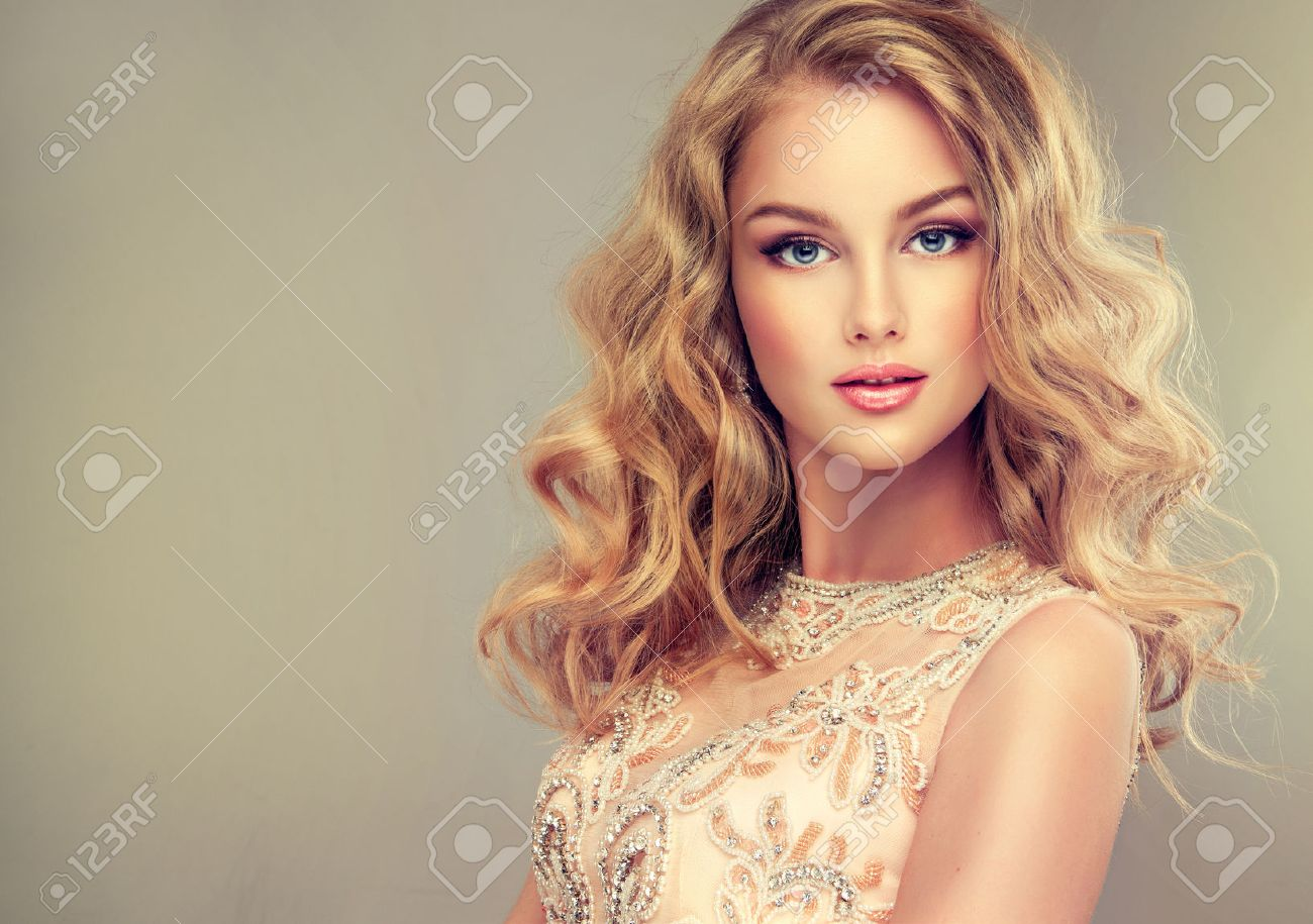 Young Beautiful Woman, Dressed In Evening Gown. Loose,wavy Hair ...