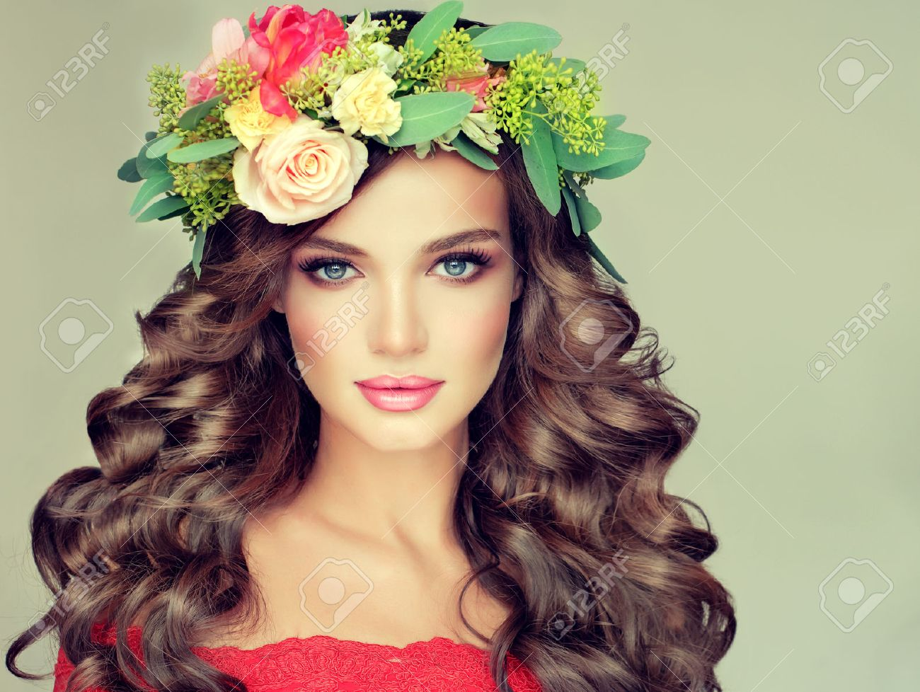 Beautiful woman model brunette with long curly hair floral wreath on the head . Spring girl. - 56304742