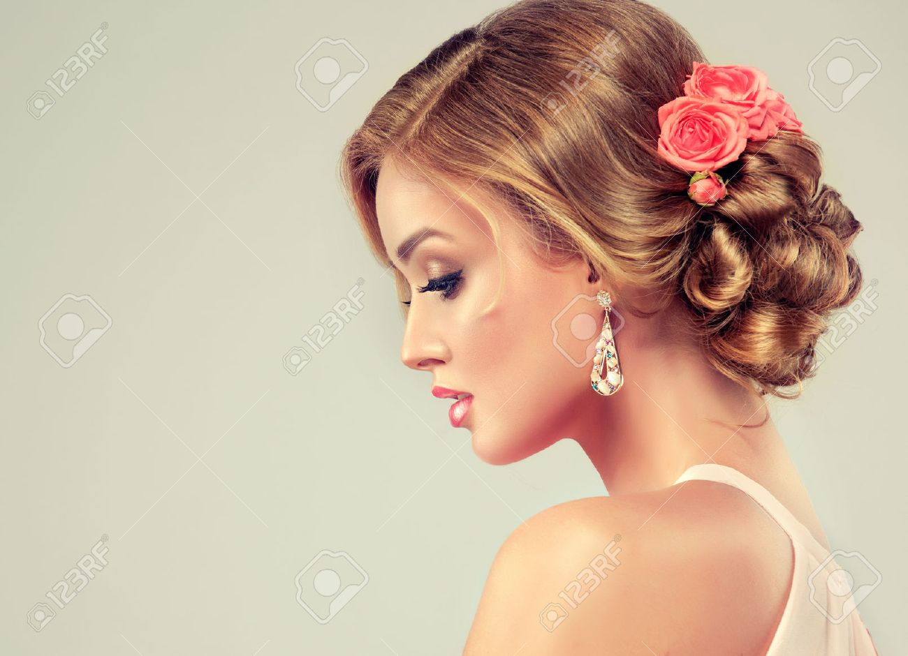Beautiful Woman With Colourful Makeup And Fashion Wedding Hairstyle