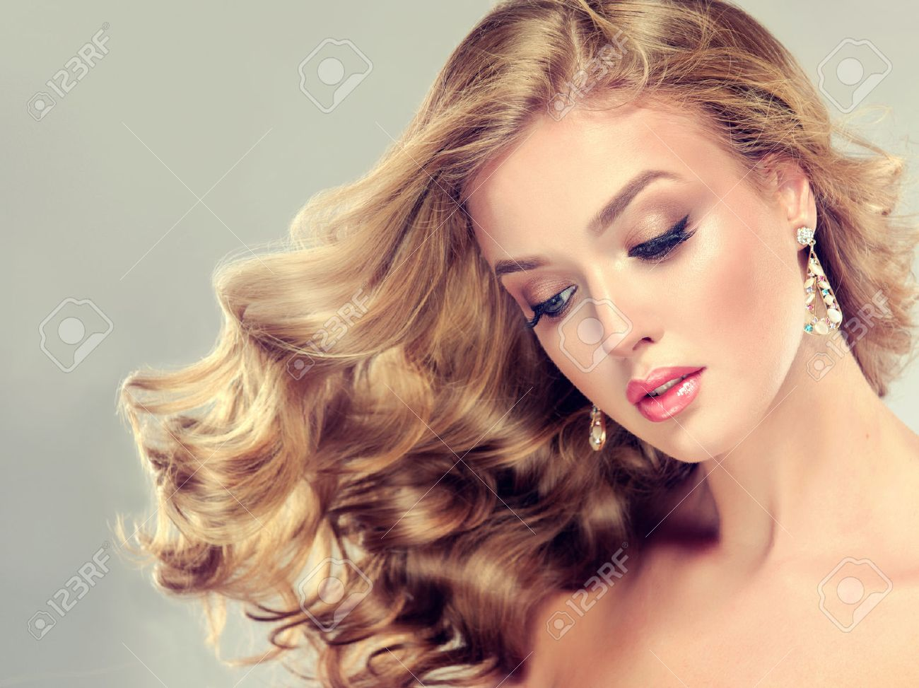 Beautiful Girl Blonde Hair With An Elegant Hairstyle Wavy Hair