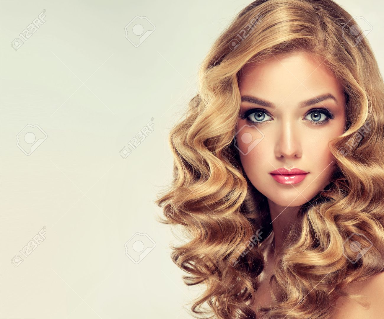 Beautiful Girl Blonde. Hair With An Elegant Hairstyle, Wavy Hair ...