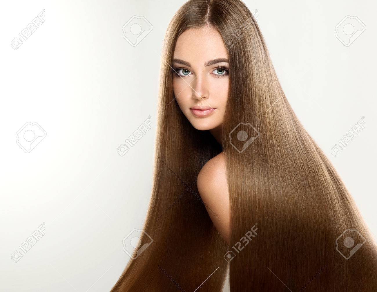 Young attractive girl-model with gorgeous, shiny, long, straight hair. Good and healthy hair as resalt of right care. - 64010245