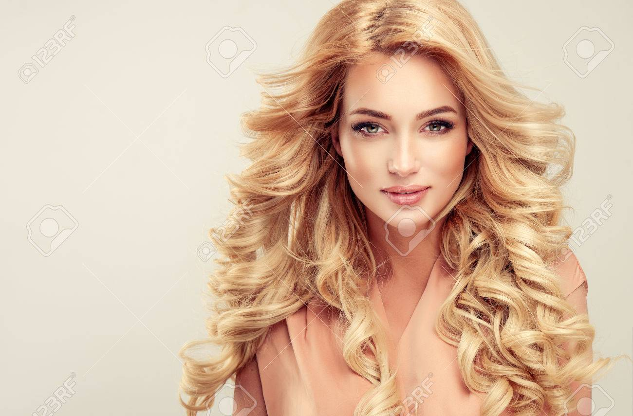 attractive woman blonde with elegant hairstyle example of long
