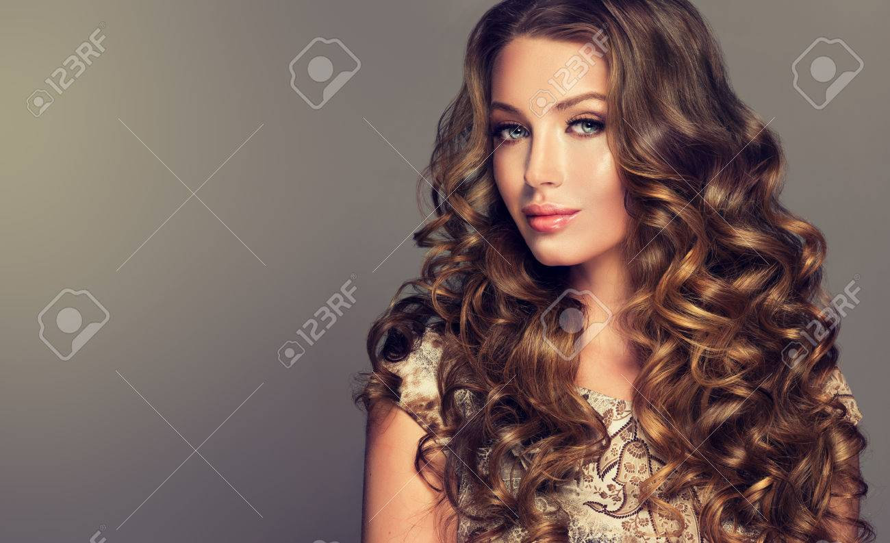 Voluminous hairstyles for long hair - Young Woman Brunette With Voluminous Shiny And Wavy Hair Beautiful Model With Long