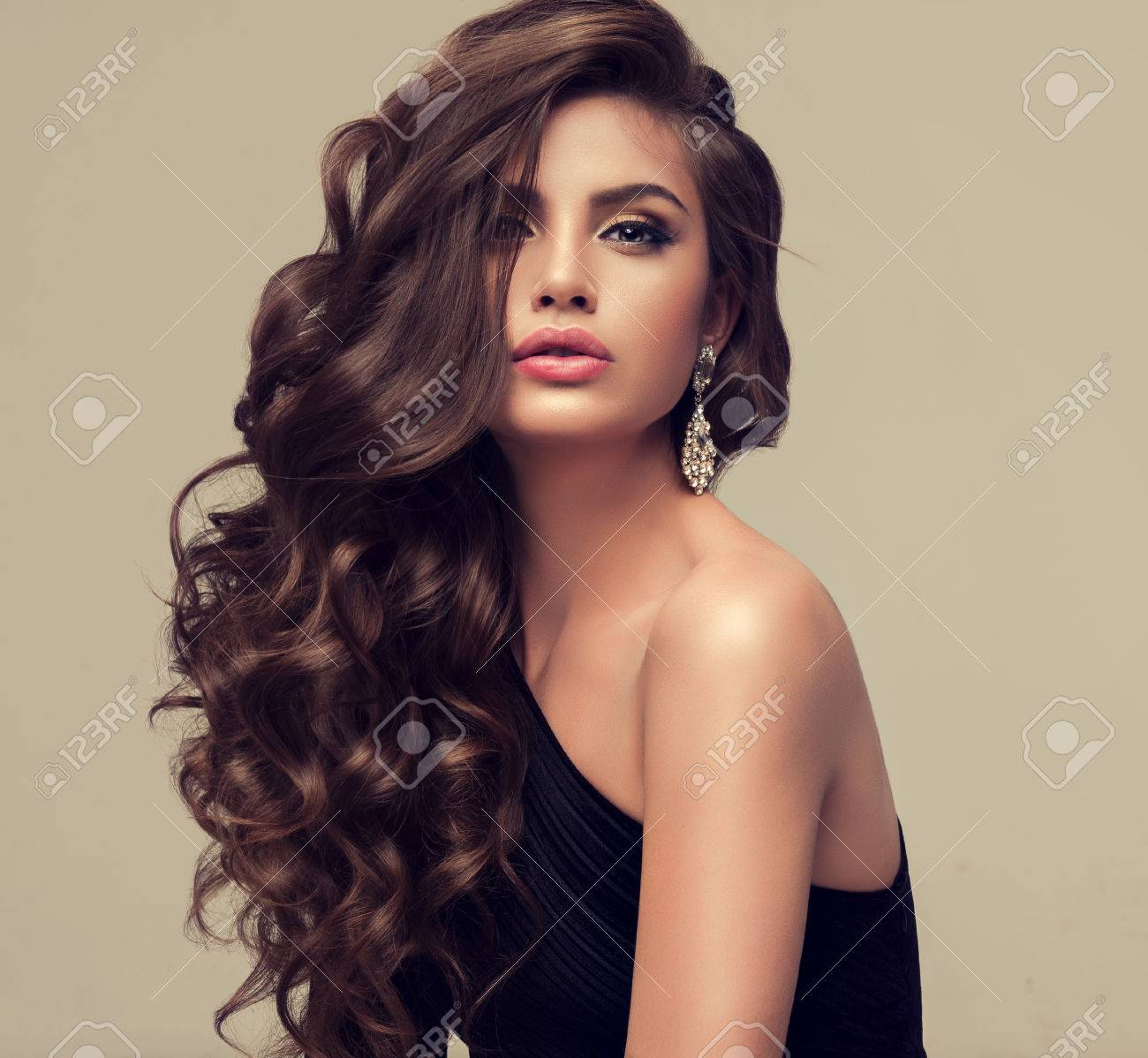 young woman brunette with voluminous shiny and wavy hair