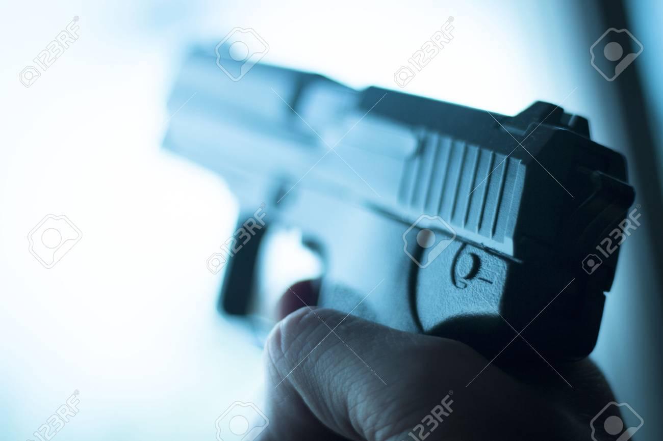 Automatic 9mm pistol handgun weapon in blue photo. - 53654798