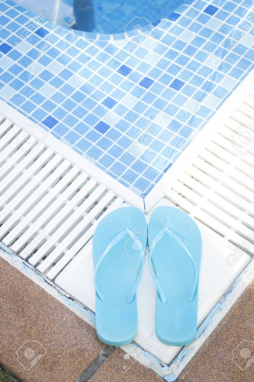16accd146a3e Outdoor swimming pool water on hot summerday in luxury hotel with blue  ladies flip flop beach