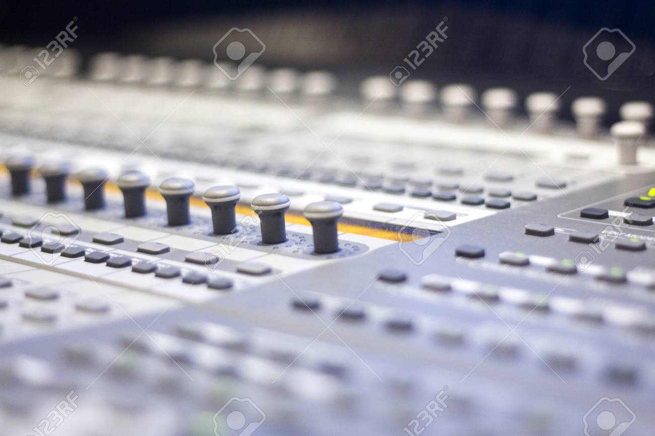 Recording studio mixing desk used to mix voiceover voice, singing