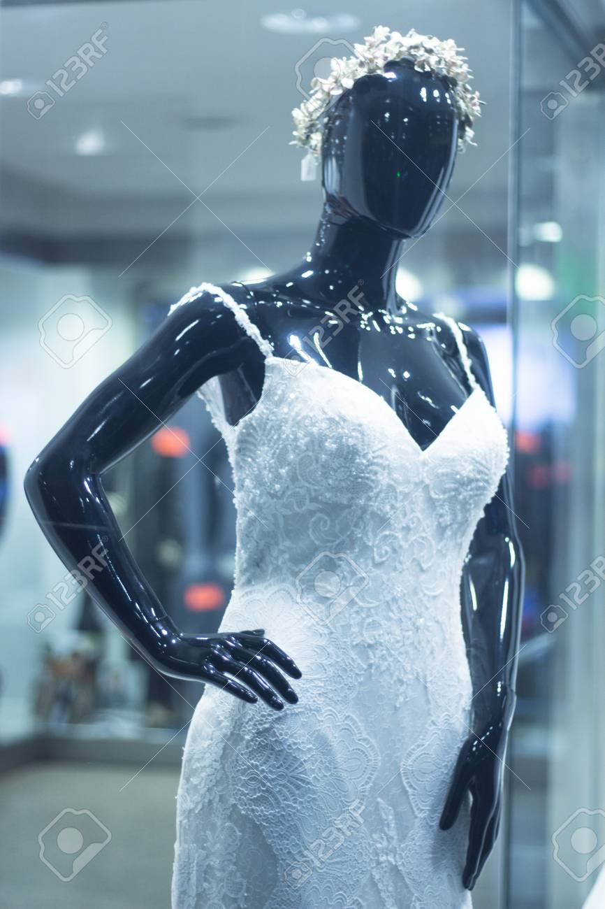 57d4b64460e5 Bridal shop dummy bride mannequin in department store with white wedding  dress. Stock Photo -