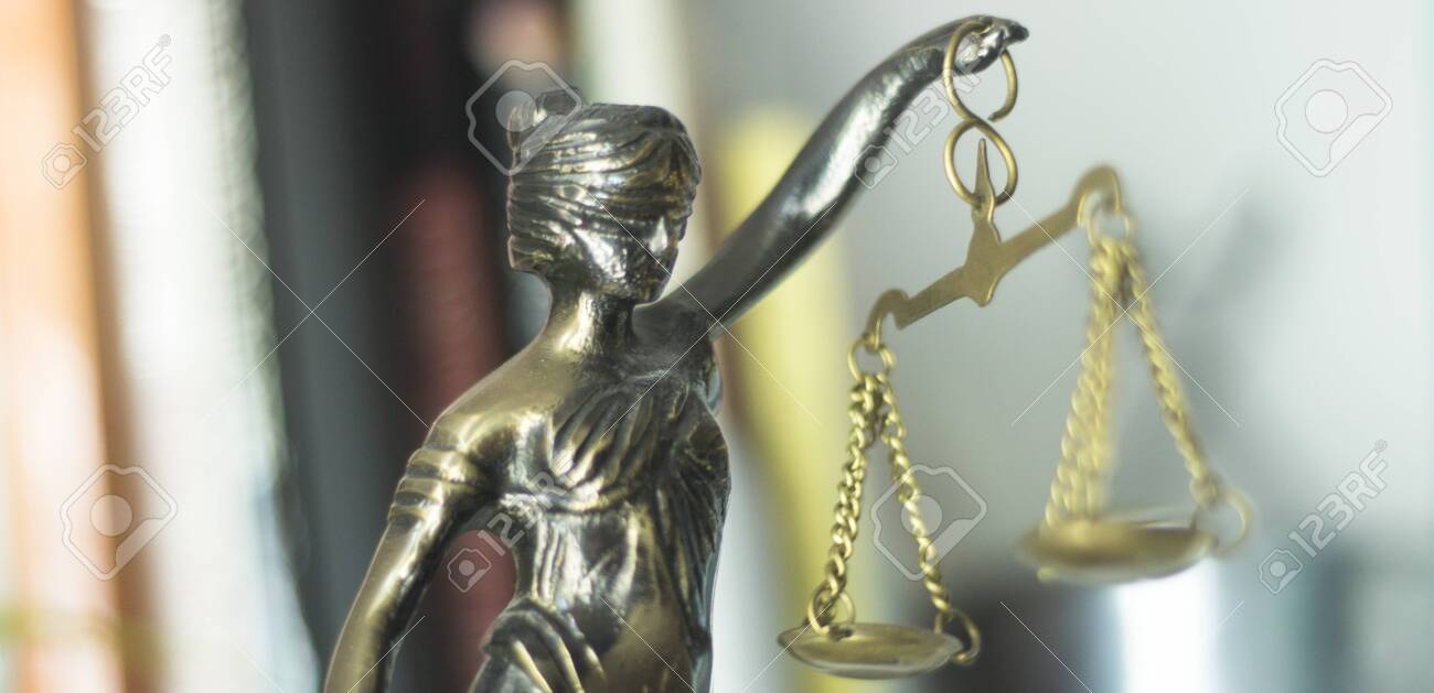 Legal law firm bronze statue of the goddess themis with scales of justice in attorneys office. - 122896887