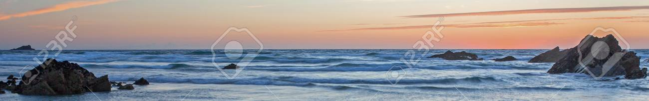 Sunset over waves and sea with beautiful reflections - taken at Fistral Beach, in Cornwall, UK Stock Photo - 17364778