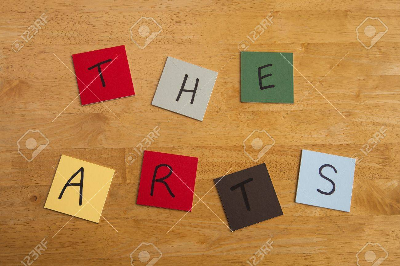 'The Arts' in capital letters and words, arty design on square color tiles on wooden background - series Stock Photo - 17453481