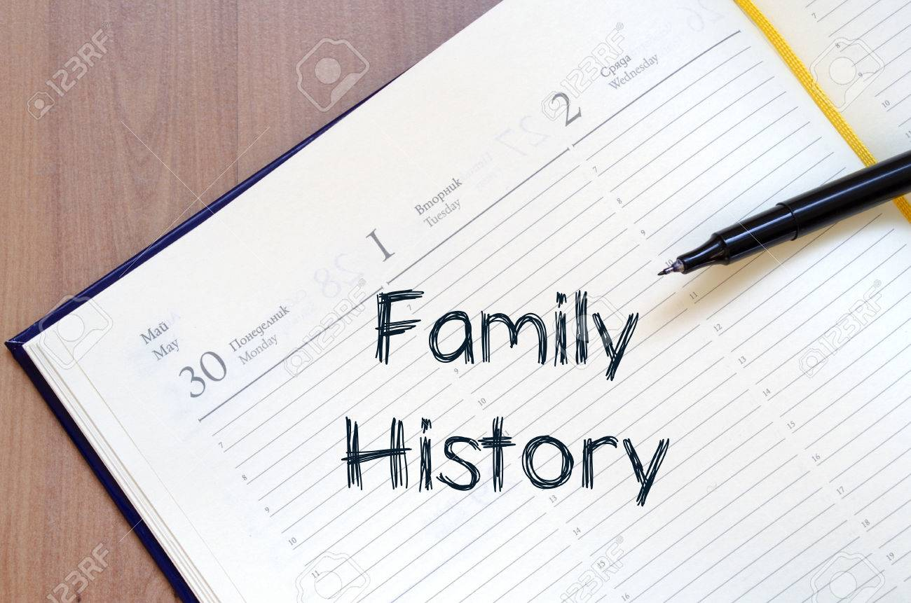 family history text concept write on notebook with pen stock photo