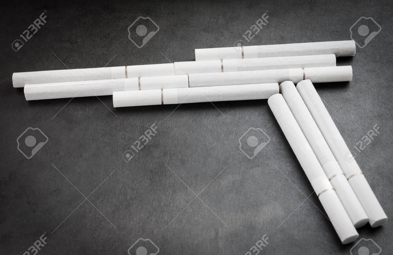Cigarette like a gun. Concept photo. Stock Photo - 19791120