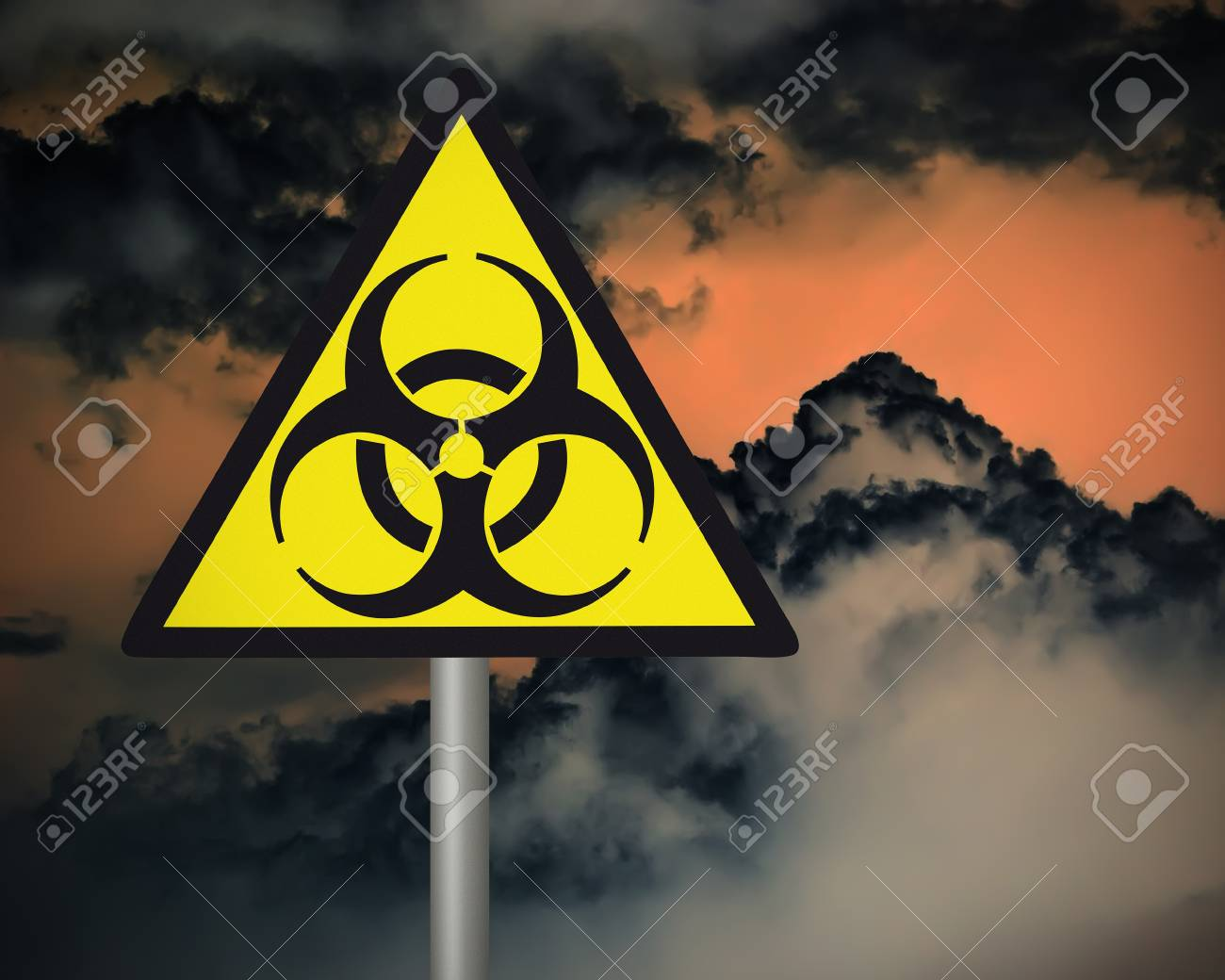 Yellow biohazard warning sign on against dark cloudy sky Stock Photo - 21384092