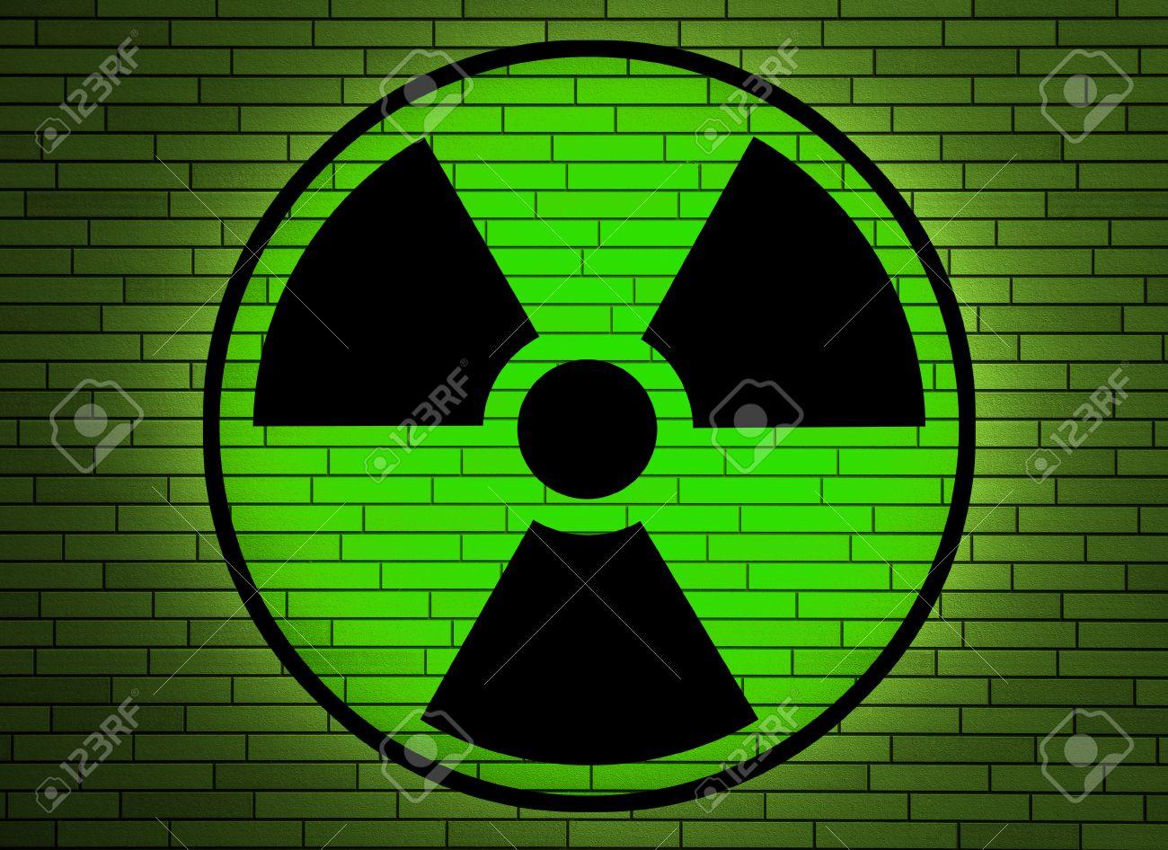 Radiation sign on a brick wall Stock Photo - 25638830