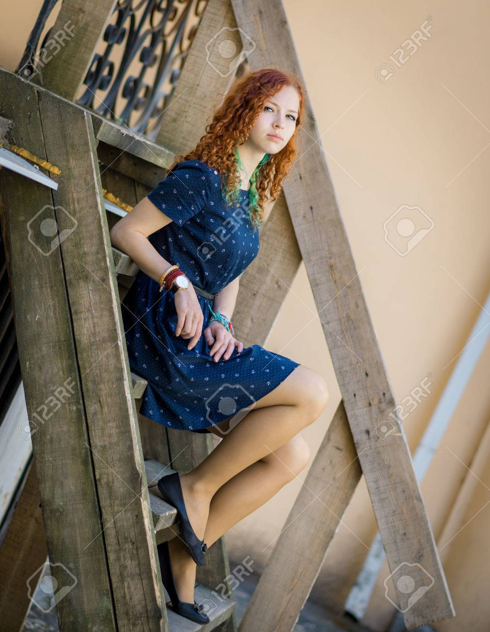 Beautiful Redhead Girl Sitting On Old Wooden Stairs Soft Focus
