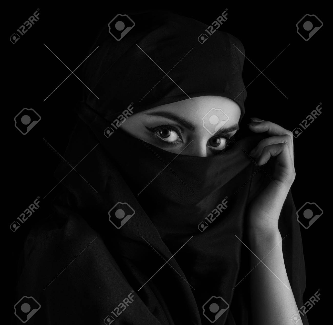 Stock photo young woman wearing hijab on black black and white toning