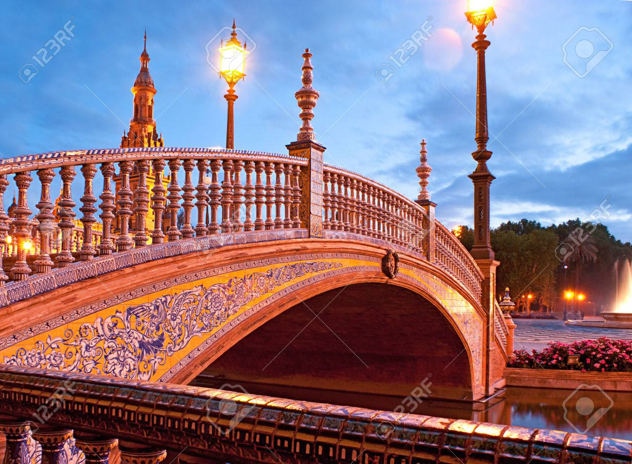 The tiny bridge decorated with painted tiles ceramic hand rails the tiny bridge decorated with painted tiles ceramic hand rails and scenic streetlights spain dailygadgetfo Images