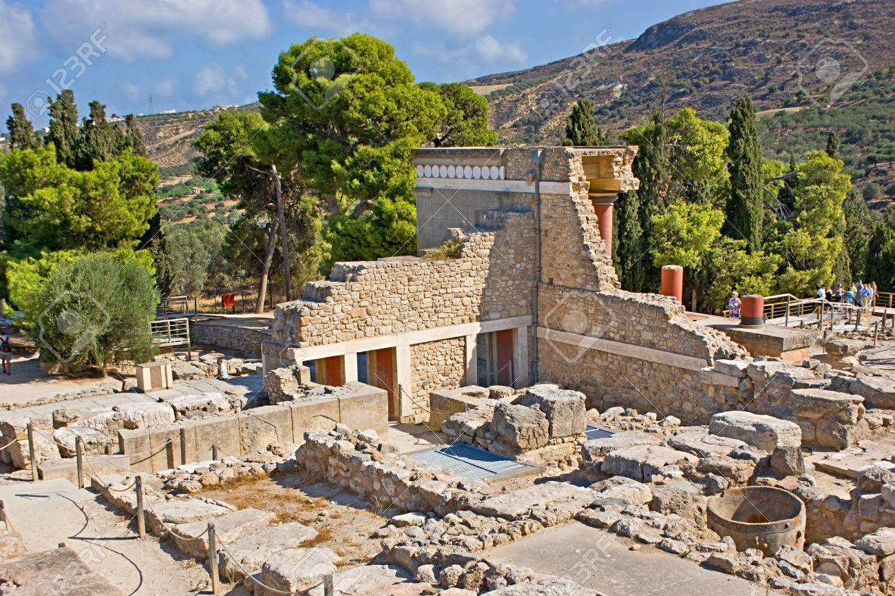HERAKLION, GREECE - OCTOBER 13, 2013: The ruins of Knossos Palace include preserved or renovated parts of chambers, halls, corridors, staircases, frescoes on big archaeological area, on October 13 in Heraklion. Stock Photo - 27854877