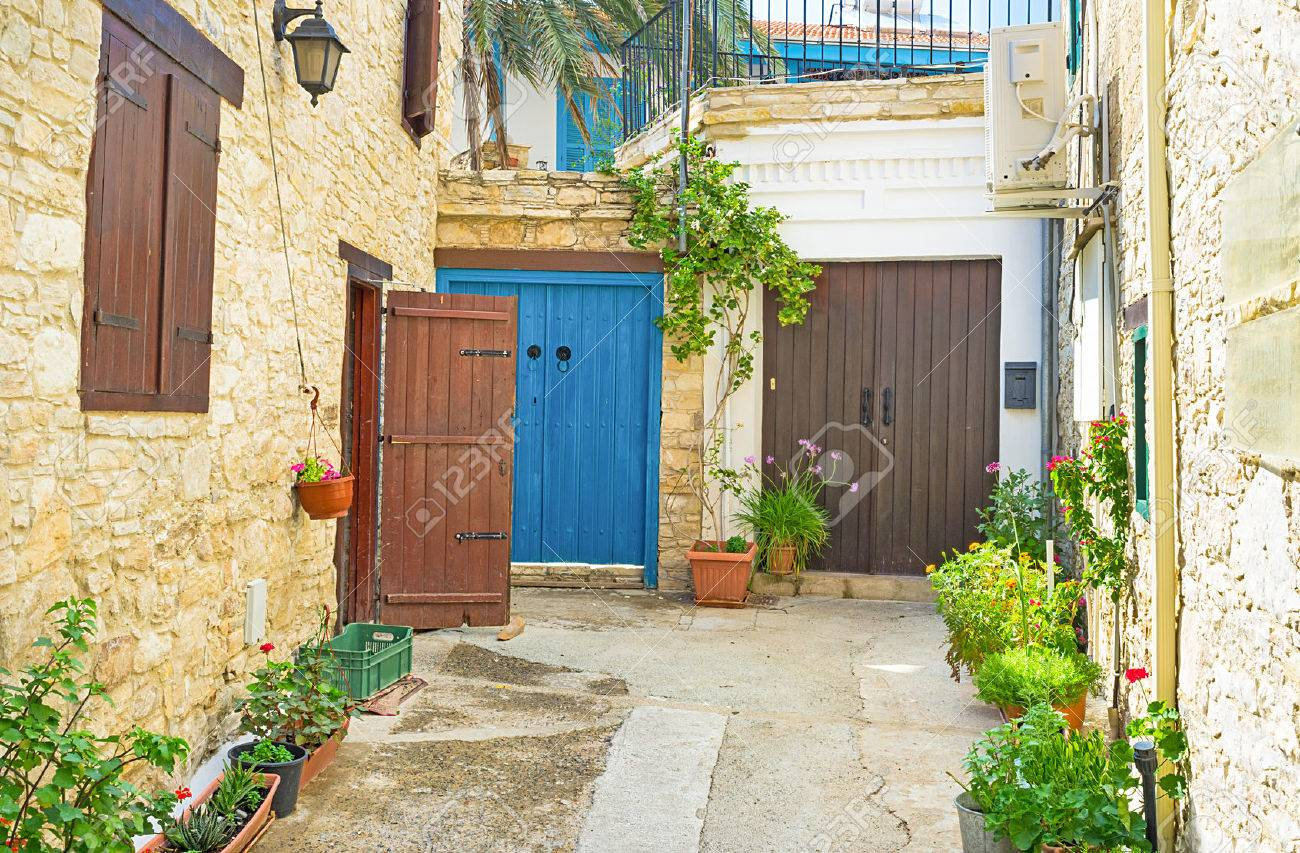 The Small Yard Leads To The Colorful Doors Of The Old Houses
