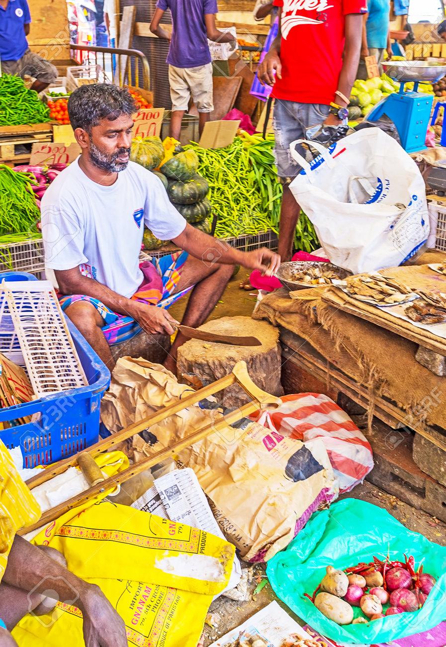 COLOMBO, SRI LANKA - DECEMBER 6, 2016: The seller of dried fish