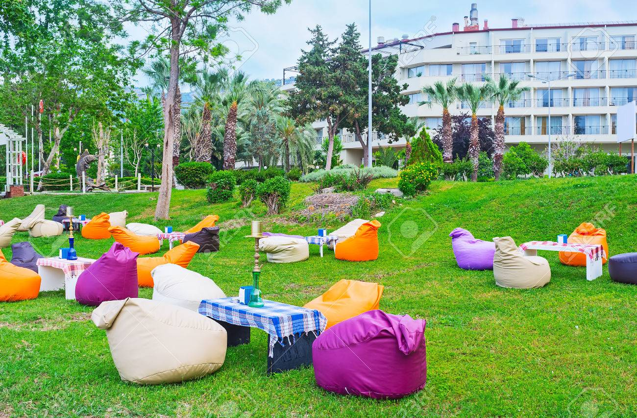 Stock Photo   The Lovely Outdoor Lounge Cafe With Colorful Bean Bag Chairs  And Shishas On Tables, Kemer, Turkey.