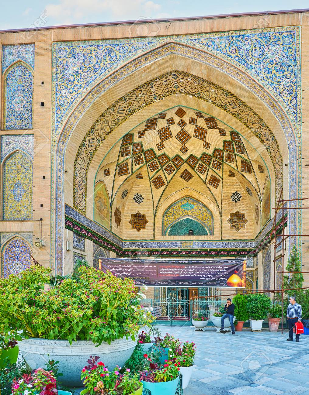 Tehran iran october 11 2017 the facade of shahs mosque stock stock photo tehran iran october 11 2017 the facade of shahs mosque behind the beautiful flowers decorating its courtyard on october 11 in tehran izmirmasajfo