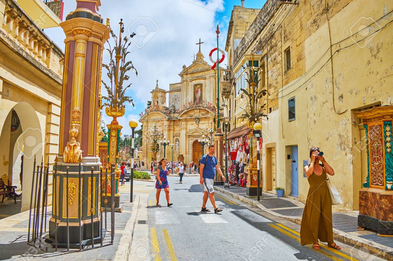 120375166 rabat malta june 16 2018 narrow street of old town lined with historic mansions decorated with city