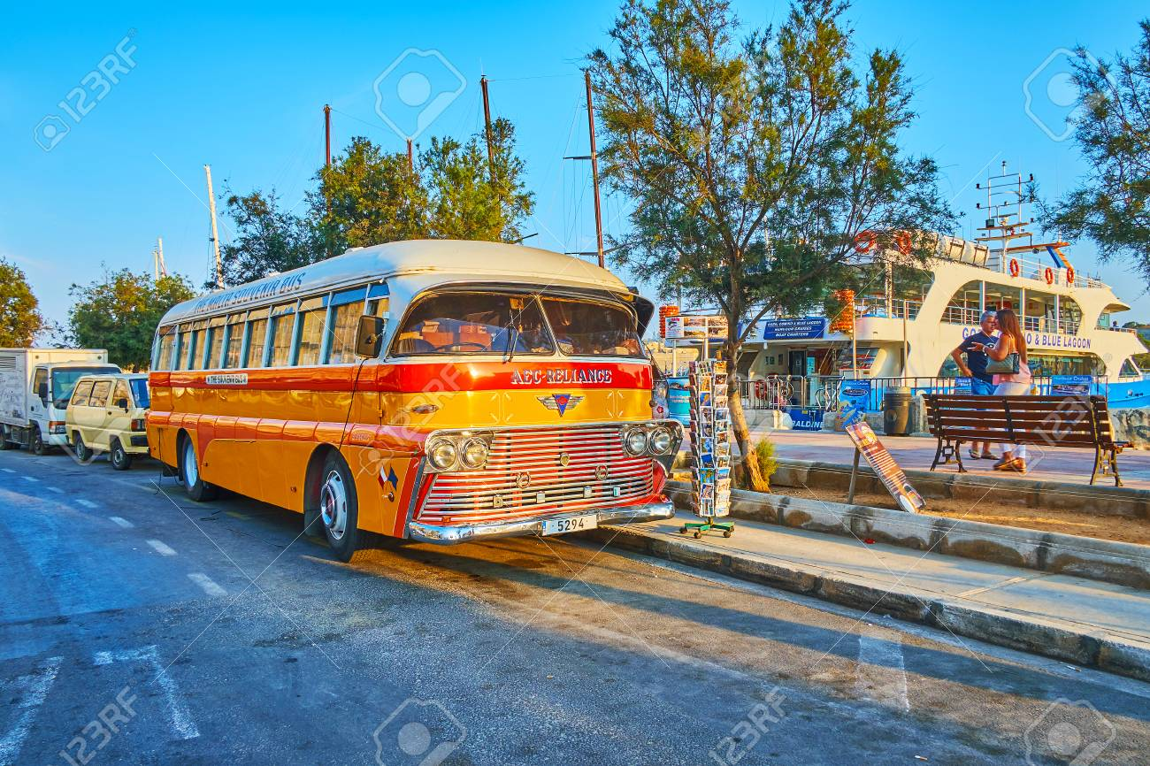 SLIEMA, MALTA - JUNE 19, 2018: The vintage AEC-Reliance bus, parked at the seaside promenade, serves as the souvenir store and attracts the tourists, walking around the harbor, on June 19 in Sliema - 124200940