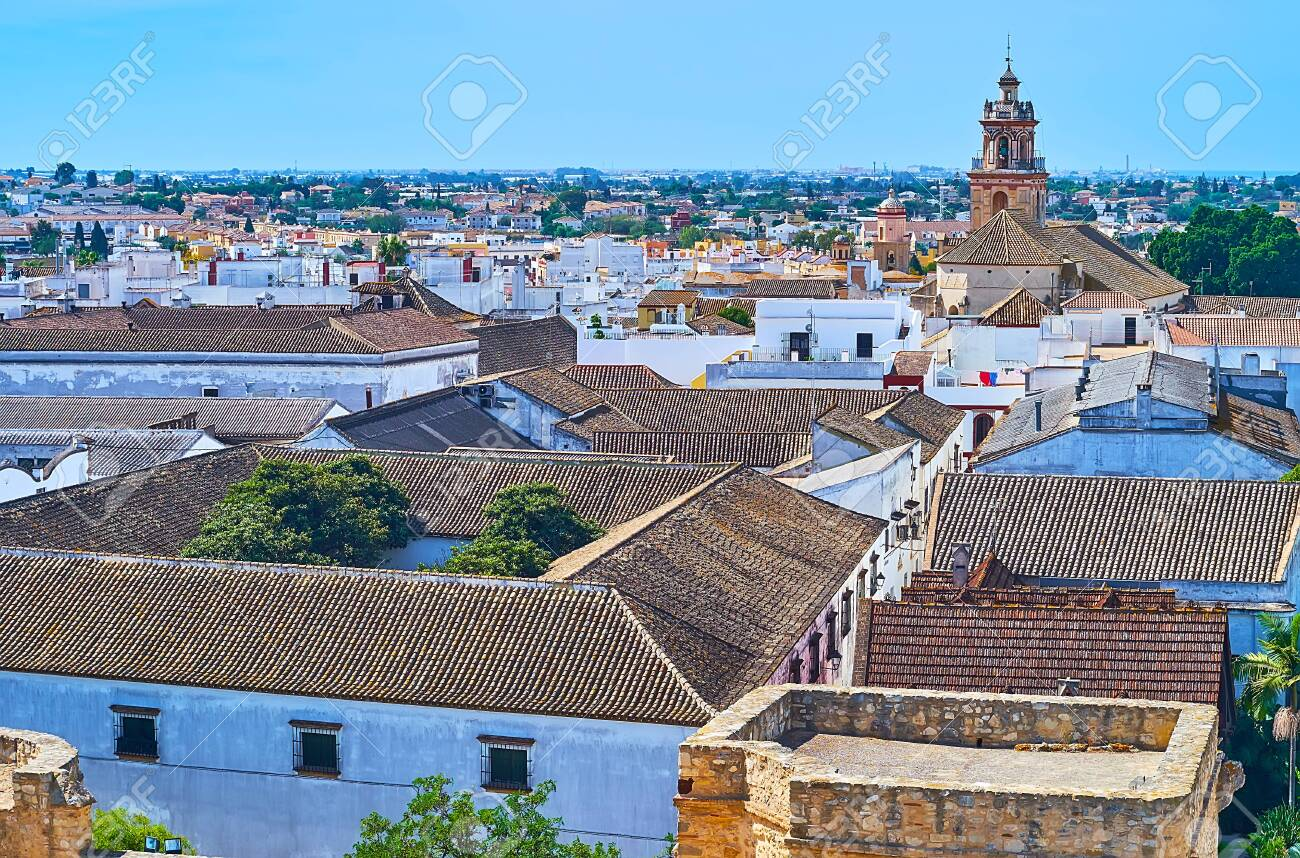 Aerial view of Bodegas Barbadillo winery roofs and bell tower of Our Lady of O church, rising over the city, Sanlucar, Spain - 149097298