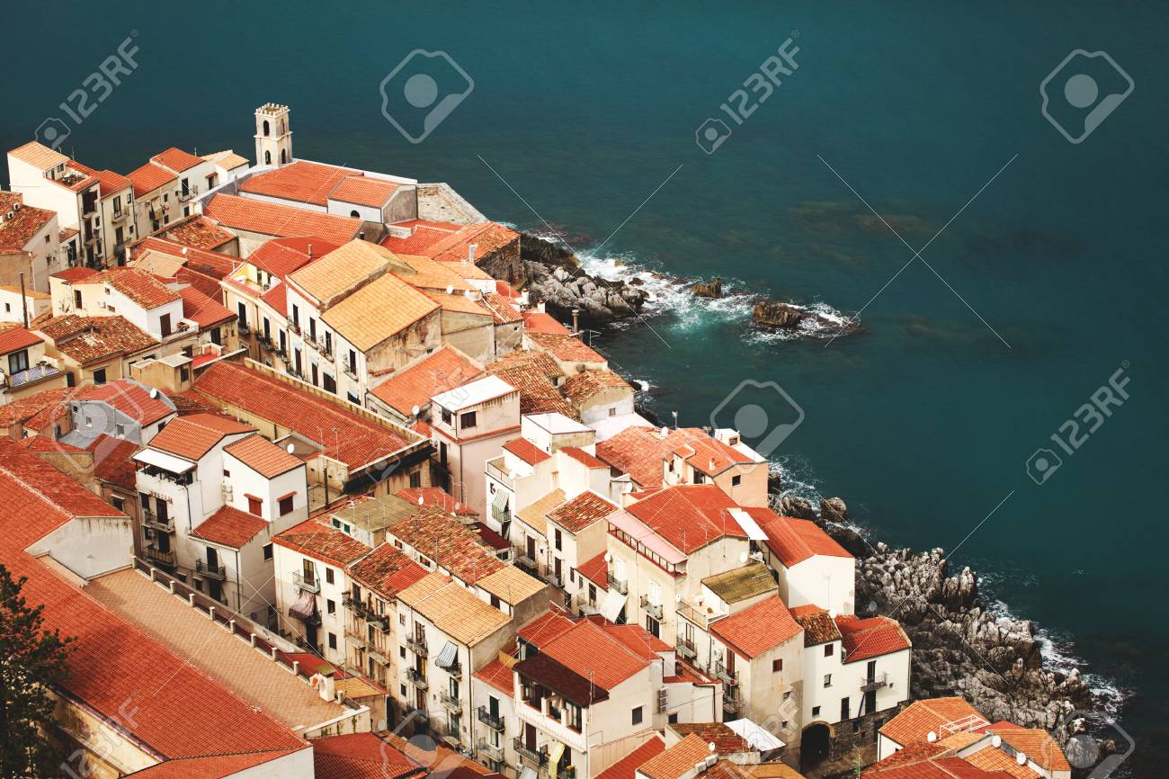 View On Old Red Roofs In Cefalu City. SIcily Island, Italy, Europe.