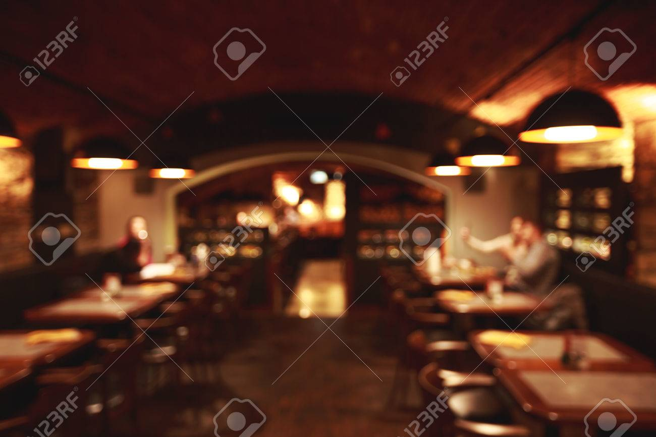 Restaurant Background With People Dark Beer Bar Blurred Background With People And Lampsstock