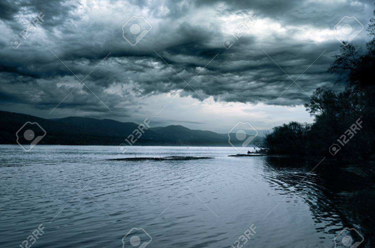 Stormy sky over the night river. - 12322463