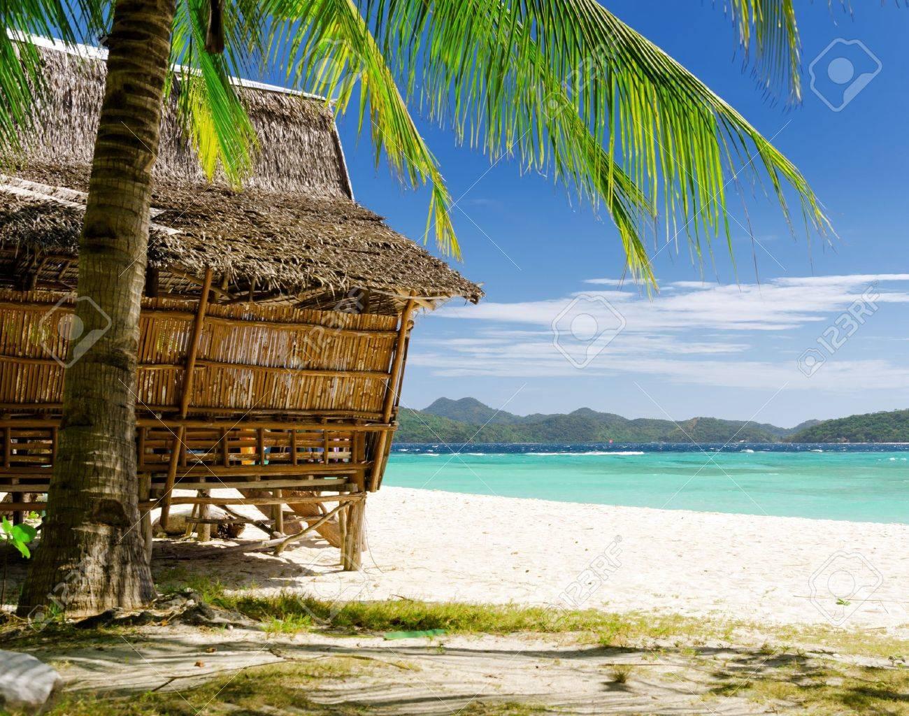 Bamboo hut on a tropical beach. Stock Photo - 14398580