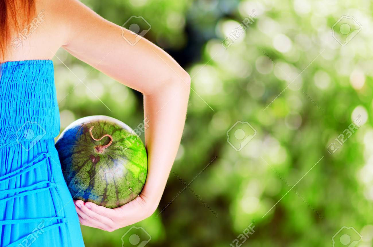 Young woman with watermelon in hands. Stock Photo - 15603644