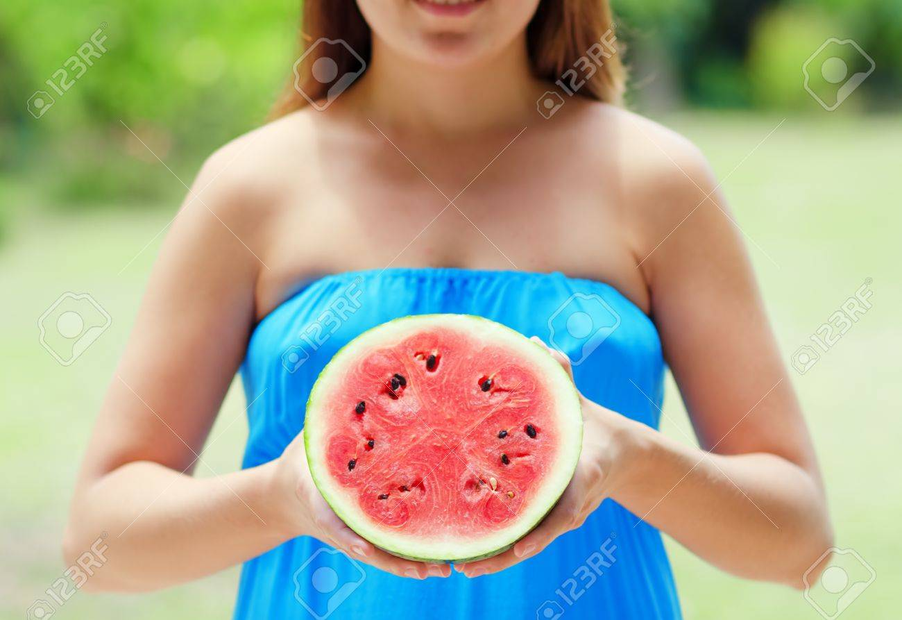 Young woman with watermelon in hands. Stock Photo - 16437130