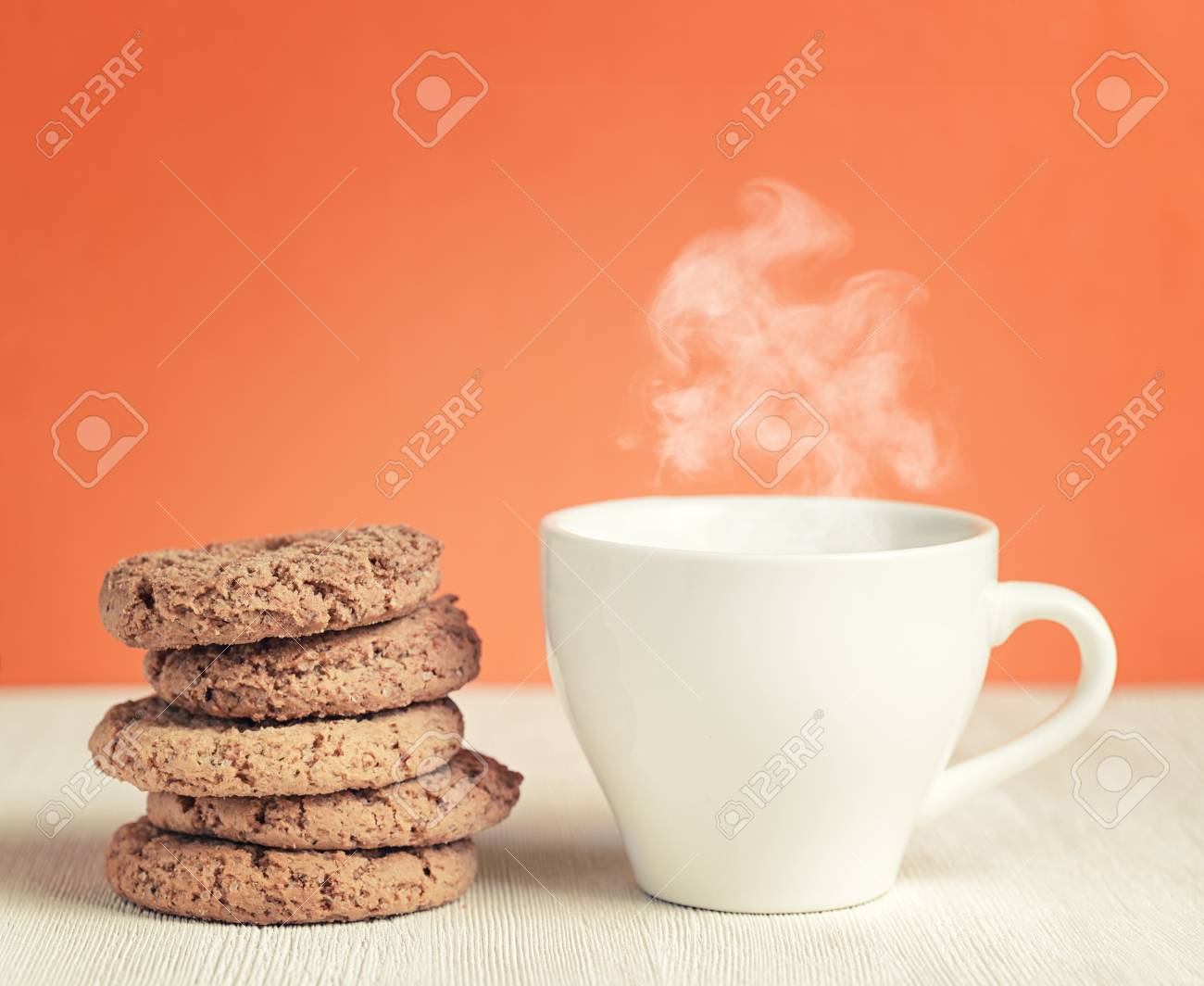Oatmeal cookies and cup of coffee on wooden table. Stock Photo - 25254120