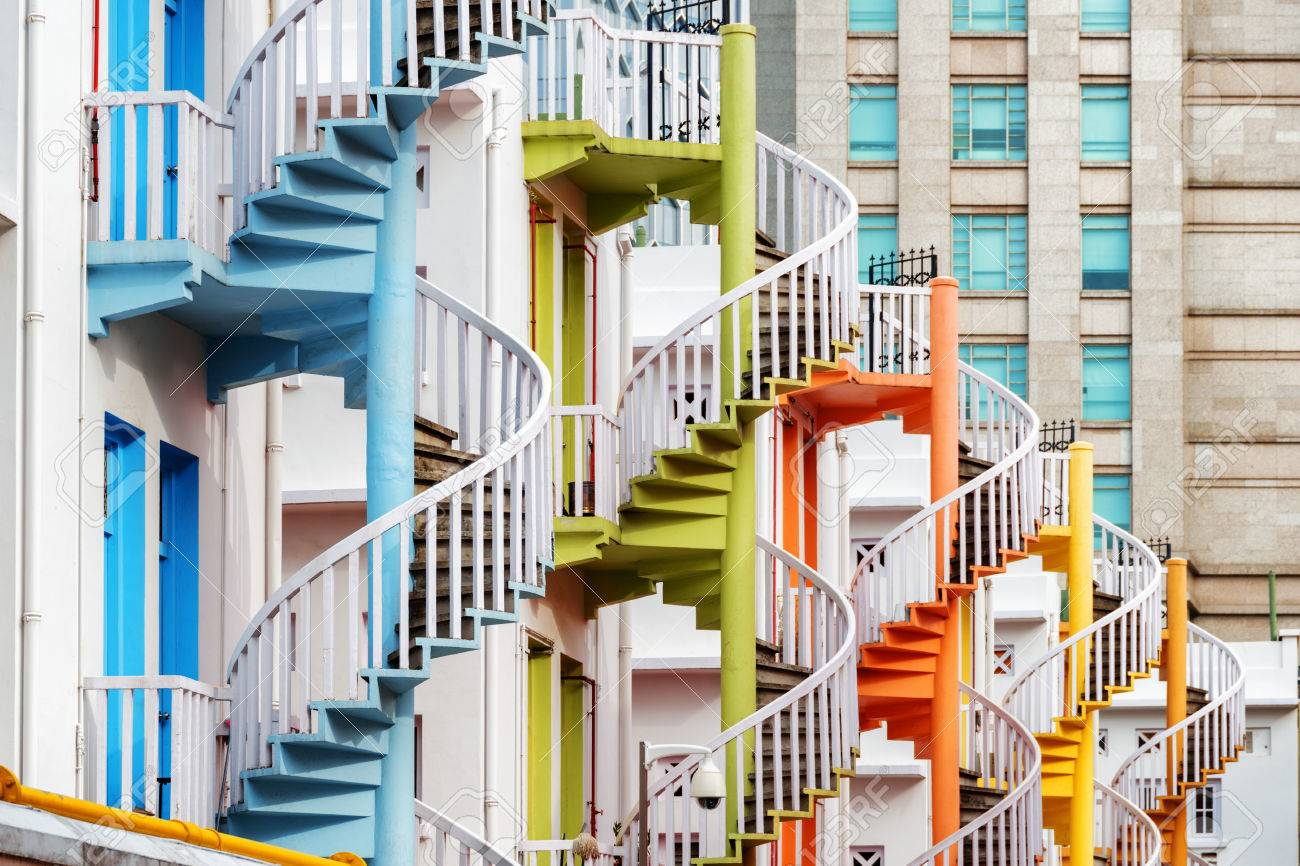 Colorful Exterior Spiral Staircases Outside A Whitewashed Building ...