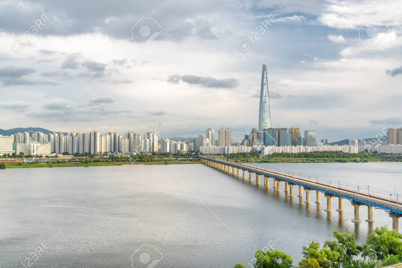 Scenic view of Jamsil Railway Bridge over the Han River (Hangang) at downtown of Seoul in South Korea. Skyscraper is visible on cloudy sky background. Wonderful cityscape. - 151926260