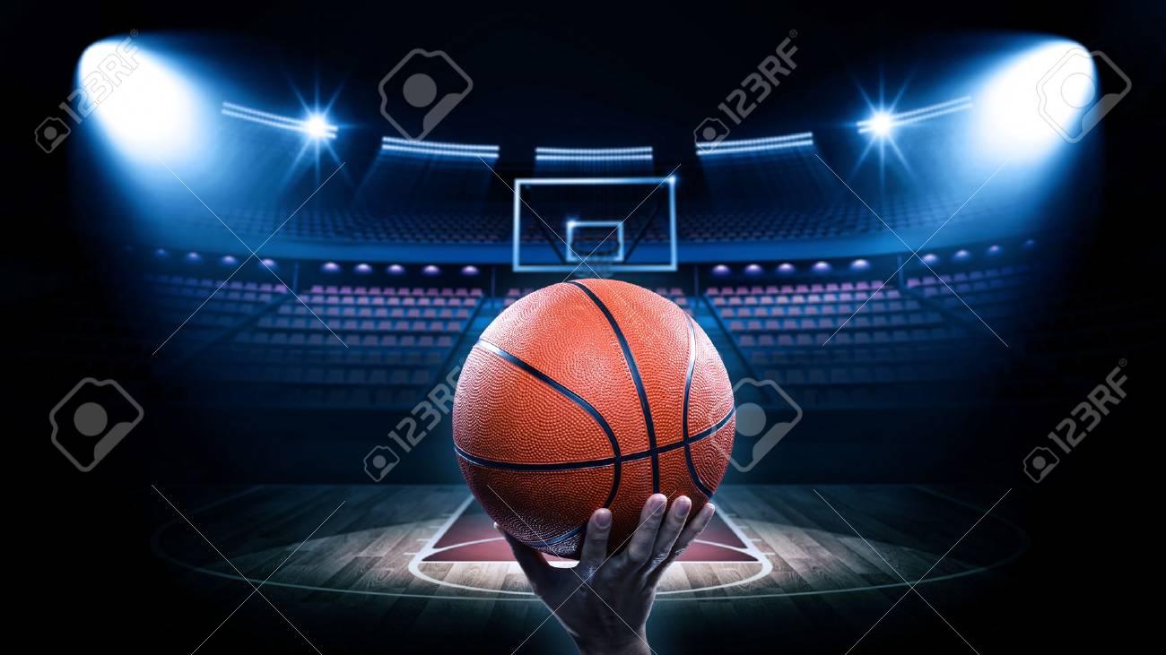 Basketball arena with player - 54429629