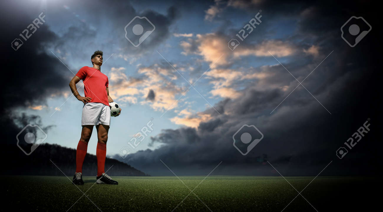 Football player and dark clouds - 166099318
